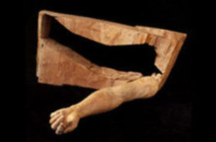 Securing sculptures such as this arm carved out of a wooden block, is one of Elizabeth's art safety procedures